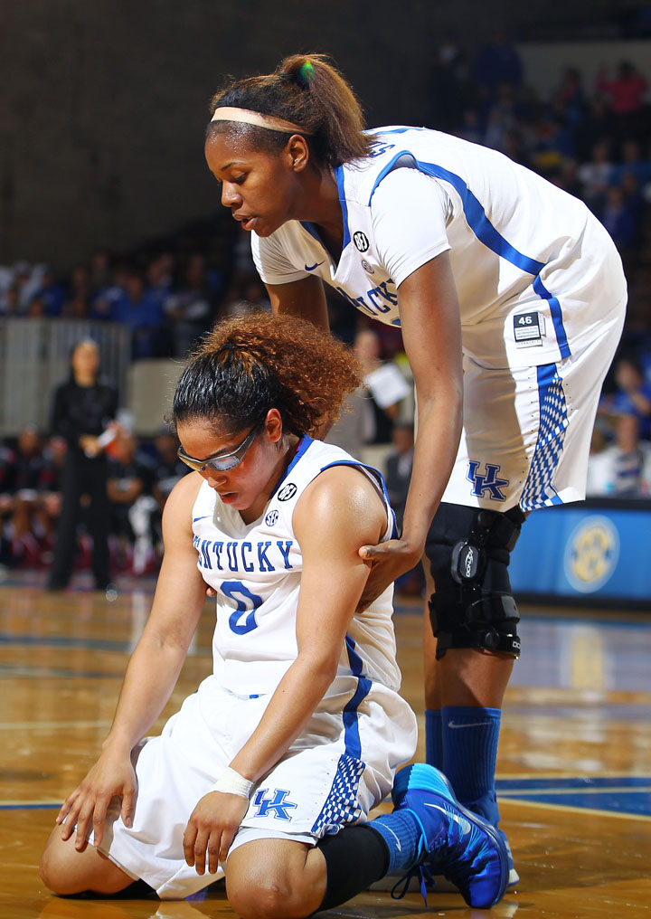 DeNesha Stallworth helps up an exhausted Jennifer O'Neill after an unfavorable call in the last few minutes of the game.