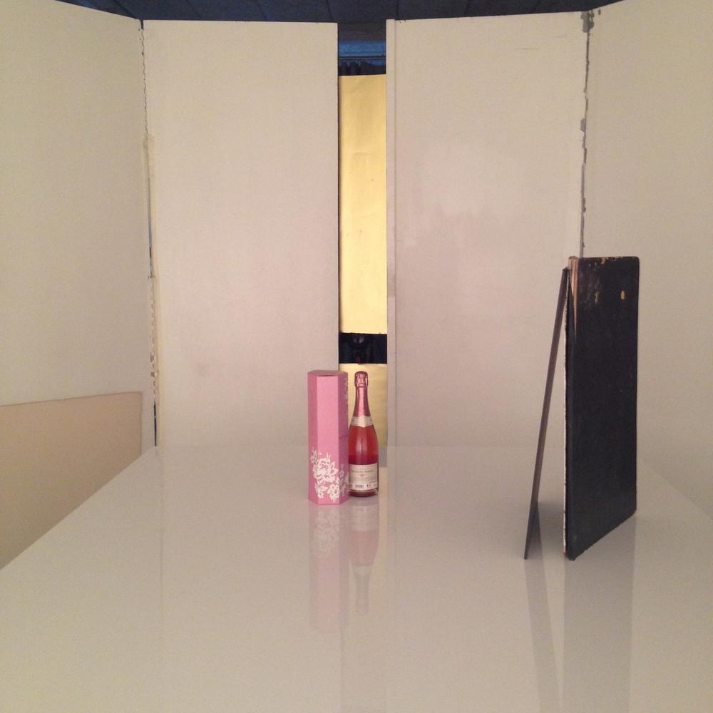 Ljussättning av flaska med box