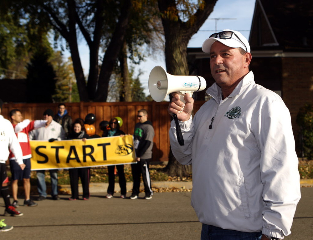 "Mayor Angelo ""Skip"" Saviano starts the 5K Tiger Tear Run/Walk at Elmwood Park High School Sunday Oct. 19, 2014. 