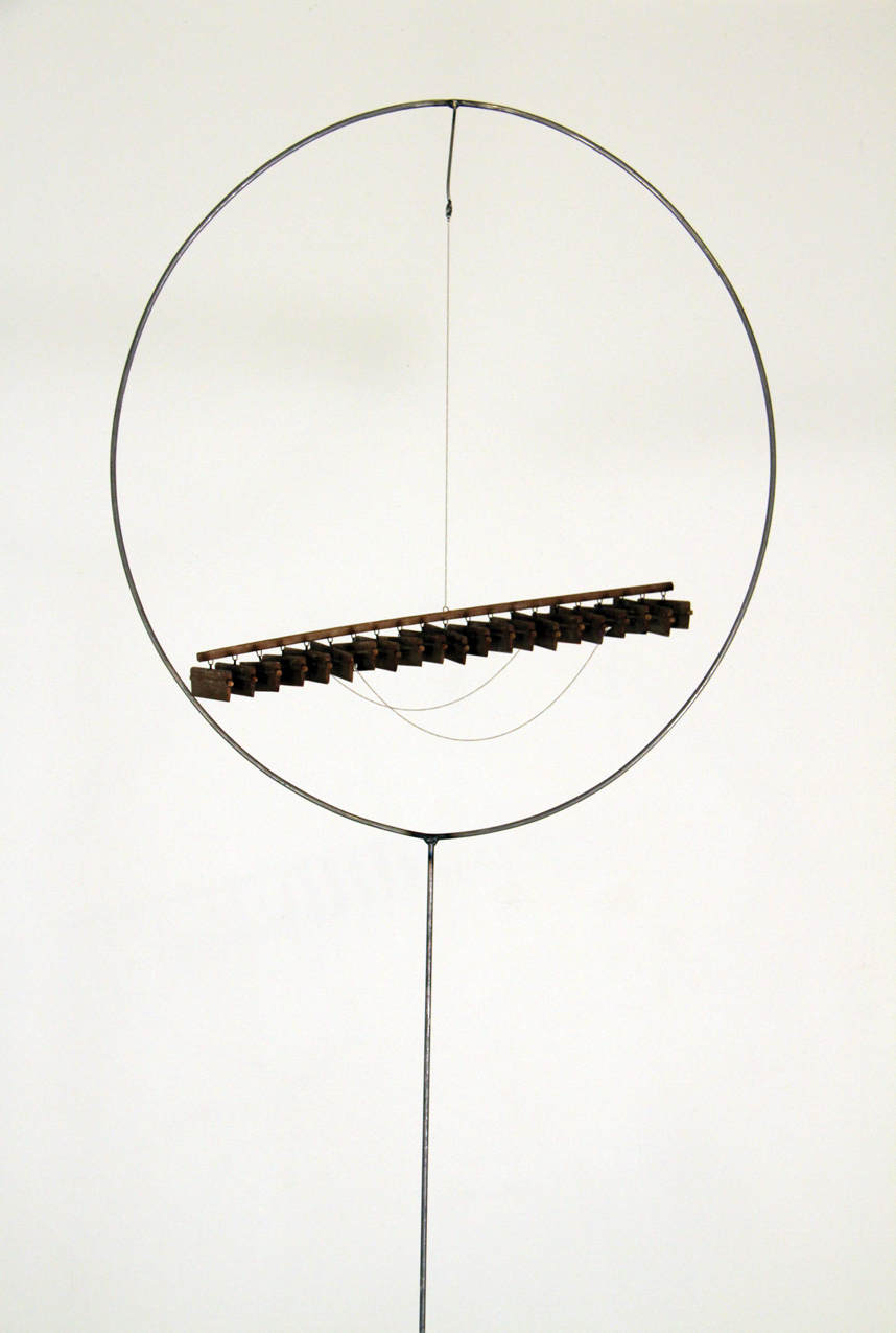 "Alison O'Daniel, Breathing Instruments, 2013, steel, chain, shutter, wood, paint, 27"" x 102.5"" x 10.25""."