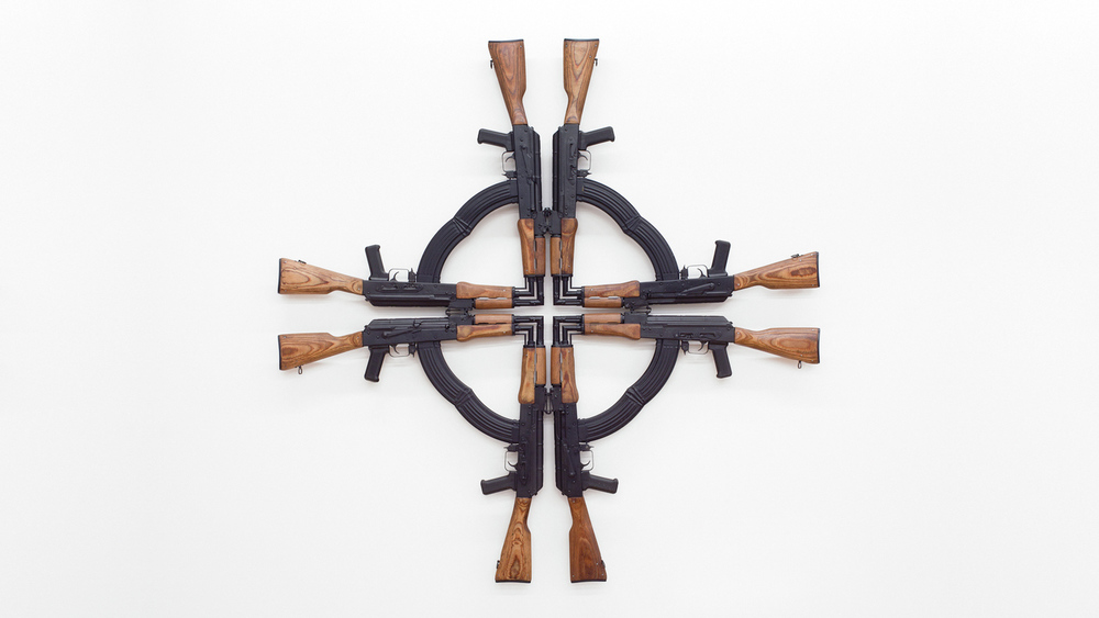 Mel Chin, Cross for the Unforgiven: 10th Anniversary Multiple (1 of 2), 2012. AK-47 assault rifles (cut and welded), 54 x 54 x 3 in.