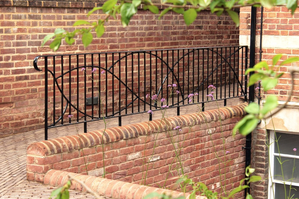 custom_iron_railings_curved_clay_pavers_porch_extension_rogue_designs_oxford