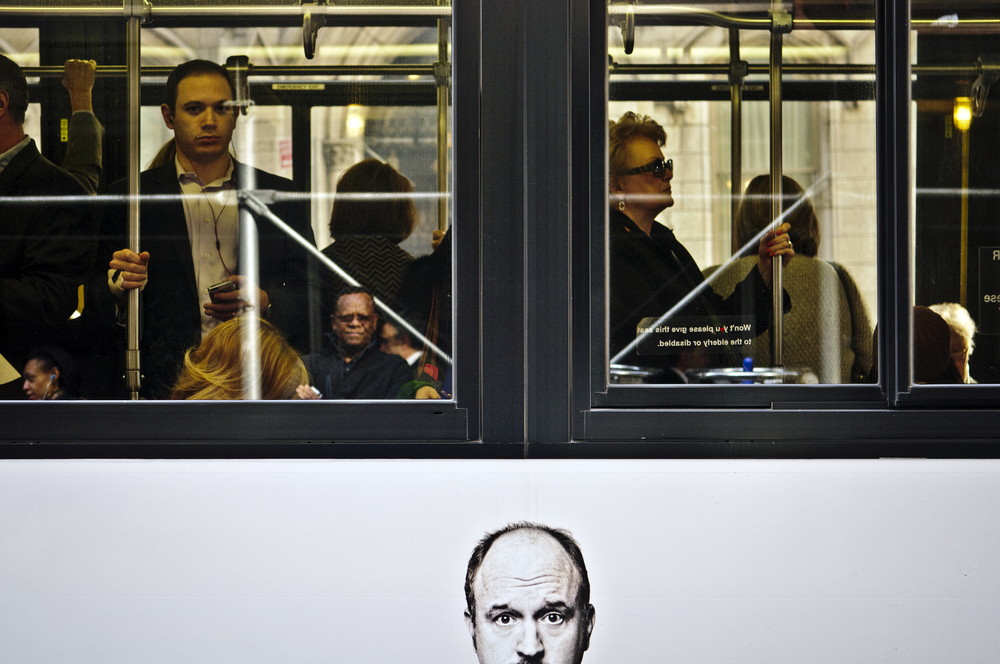 2013.04.24 – New York City, NY – A Louis C.K. poster rides under passengers aboard a northbound Broadway bus.