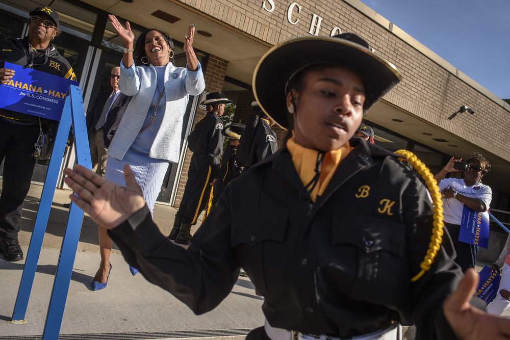 Jahana Hayes (L), who is vying for her party's endorsement, dances with supporters and members of the Berkeley Knights of Waterbury drum corps at Crosby High School before the start of the nominating convention for the Connecticut's fifth district.