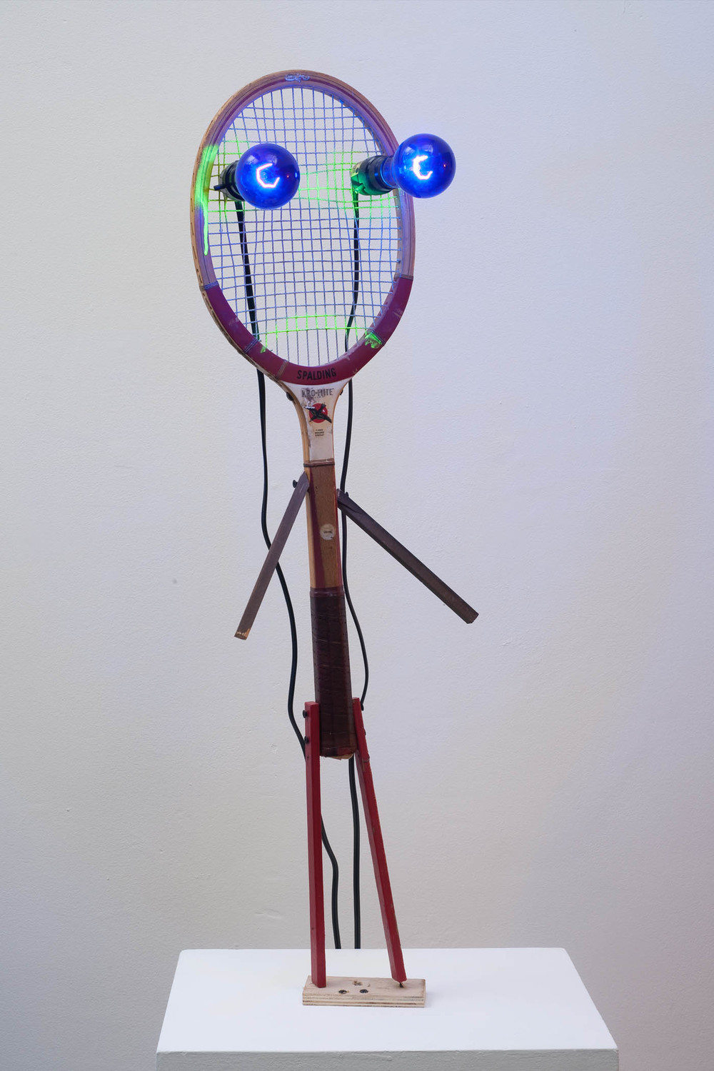 "Jon Pylypchuk, ""and without further ado, we would like to introduce spaulding king of fucks"" 2011, mixed media, tennis racket, black lights, 36""x10""x7"""