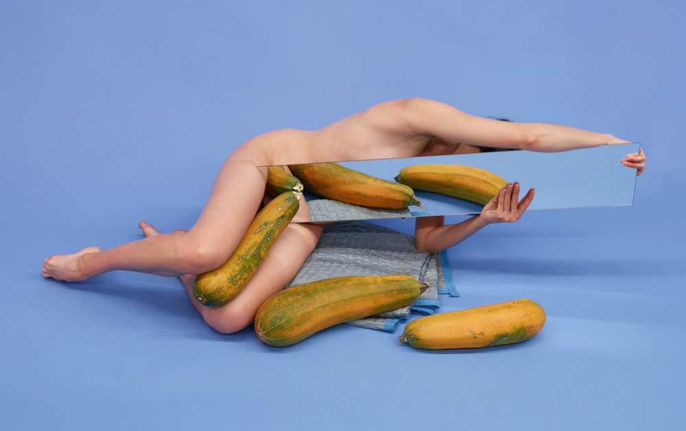 Untitled (Reaching with three squashes on blue), 201  Pigment print  20 x 32 inches