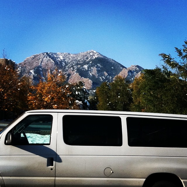 Here's a pic of our old van parked in front of the Rockies in Boulder, CO. We're excited to get back in it this weekend for our shows in NYC and PHILLY!