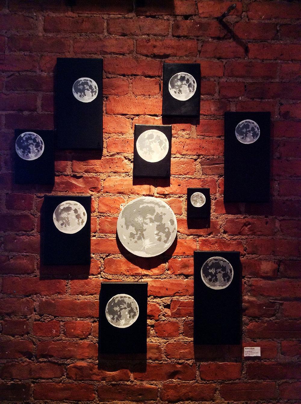 full-moon-lunar-paintings-brick-gallery-wall-matthew-woods.jpg