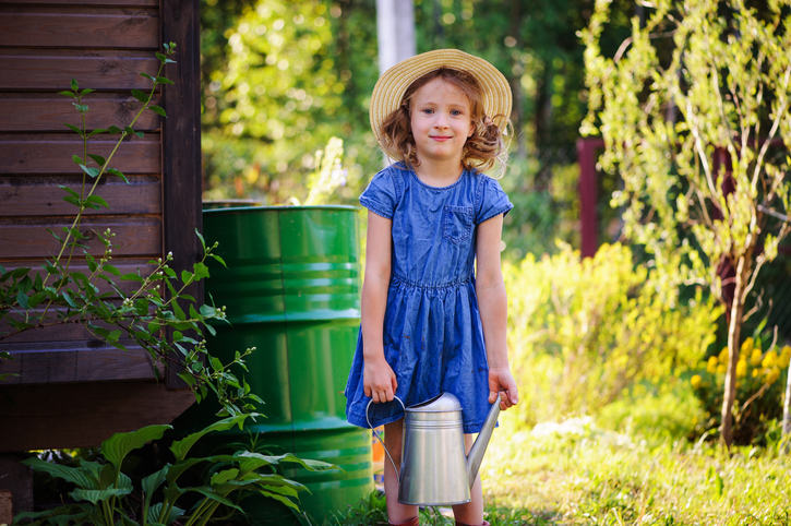 child-girl-watering-flowers-in-summer-garden,-little-helper-501194414_728x485.jpeg