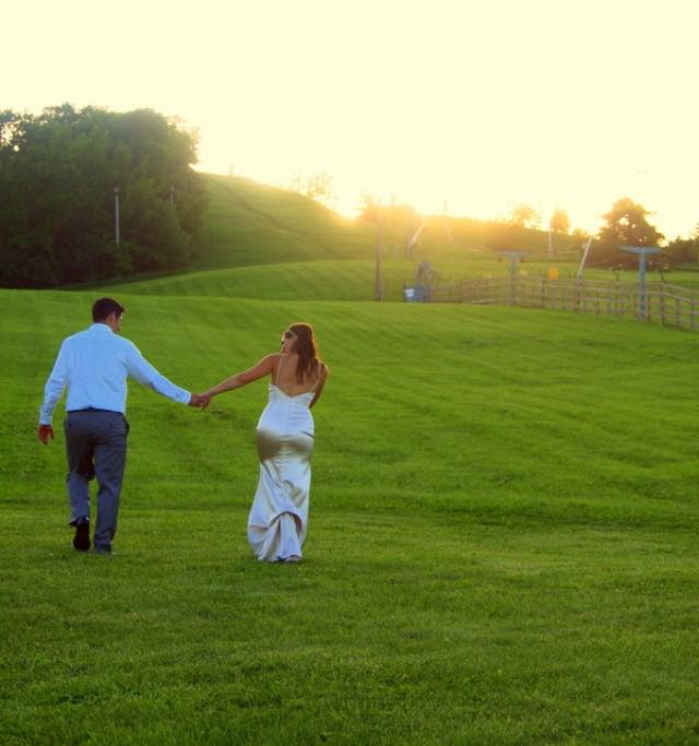 Newly Married Couple among the rolling hills at Powder Ridge
