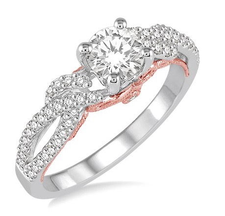 Engagement ring with rose gold accents from D.J. Bitzan Jewelers.