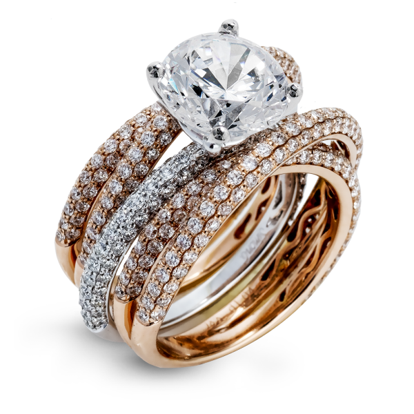 Diamond engagement ring from J.F. Kruse Jewelers with stackable wedding bands.