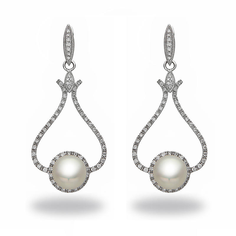 Pearl and diamond chandelier earrings from J. F. Kruse Jewelers.