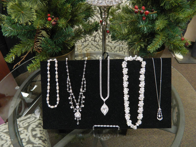 Bridal Aisle has all brand-new jewelry 40%-60% off the retail price. They are high end brand pieces that are looking for the perfect dress to compliment