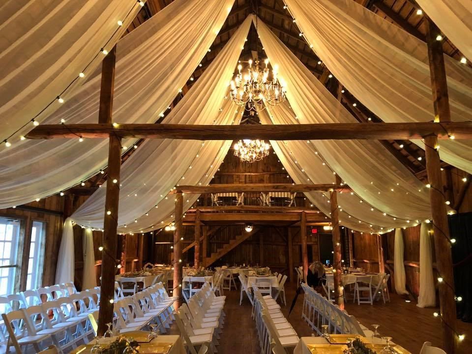 Ceiling Draping and Lighting provided by Geyer Wedding and Event Rentals