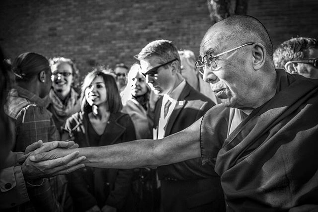 His Holiness The Dalai Lama welcomes the warm embrace of a woman during a visit to New England  a few years back.  What started out as an assignment for the @secretservice and @statedept turned into so much more.  Earning the trust of HHDLs people is not easy.  On day two of the assignment I received the request from them to stay close and shadow him and capture images and take images of him with people as he requests.  Such an honor on so many levels.  To have the opportunity to observe the Diplomatic Security teams and Secret Service up close and personal was mind blowing.  Being able to spend 48 hours with HHDL was life changing.  My camera has allowed me access to people and places I could have never dreamed of. 🙏 @dalailama @statedept for the opportunity.  BiG rework of my site with more from this series soon. #dalailama #hhdl #hisholinessthedalailama #buddhism #tibet #lovingkindness #secretservice #statedepartment #documentaryphotography #blackwhitephotography #nikon #lama #peace #dalai #happiness #photographerslife #boston