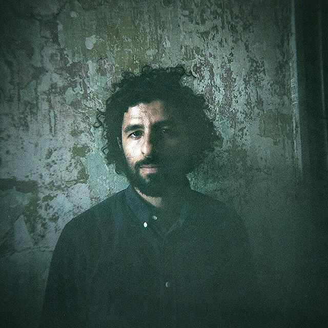 @jose.gonz.music so amazing last night at @columbustheatre.  Sound, light, and the theatre were perfect.  I took zero photos and loved it.  Awesome to finally watch him for a full set. 📷: circa 2015.  Taken at @newportfolkfest with @kodak Portra 800 with my ghetto fab Holga.  #josegonzalez #folkportraits #folk #columbustheatre #goodmusic #vestigesandclaws #inournature #veneer #portraitphotography #musicphotography #concertphotography #acousticguitar #guitarist