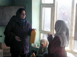 Fahima Distributing Cooking Oil to Widows