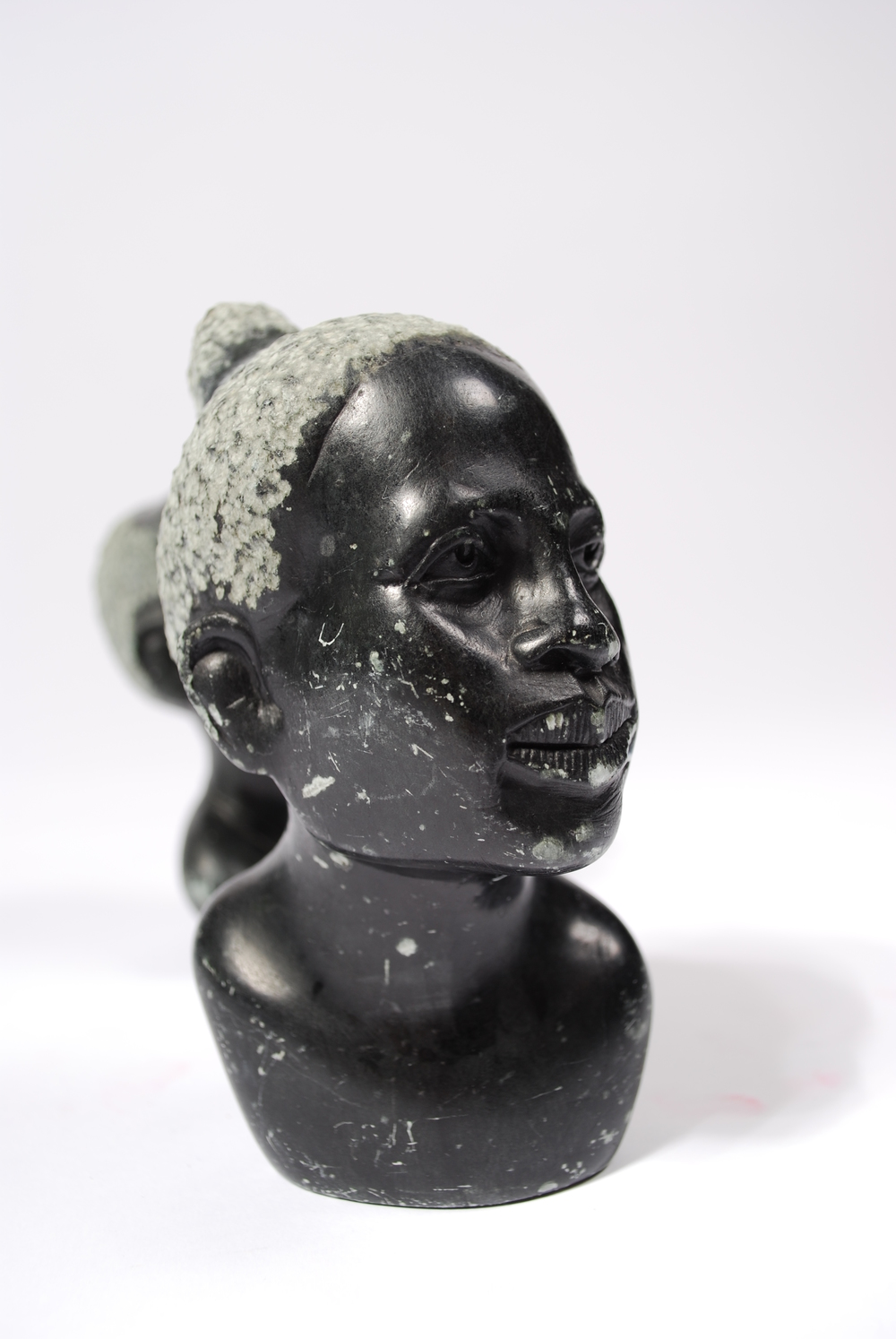 Stone curving head man and woman, marble, 50's