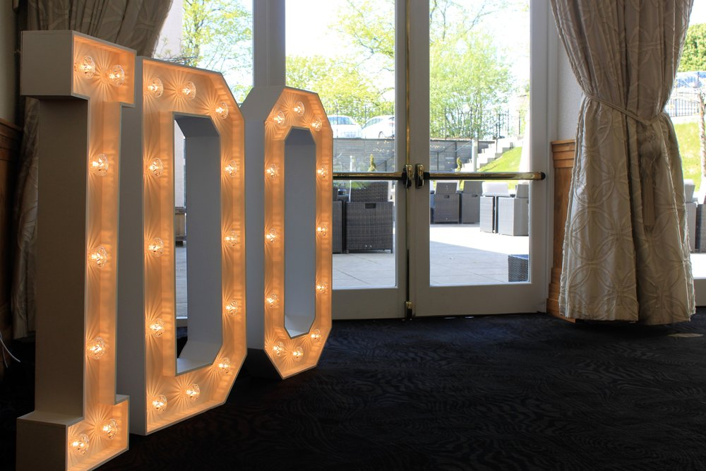 Say 'I-DO' letters - These 4ft white LED 'I-DO' letters are perfect for corner areas and limited spaces without compromising on the wow factor. Fully interchangeable using the 4ft red heart for something a bit different.Hire for only £100.