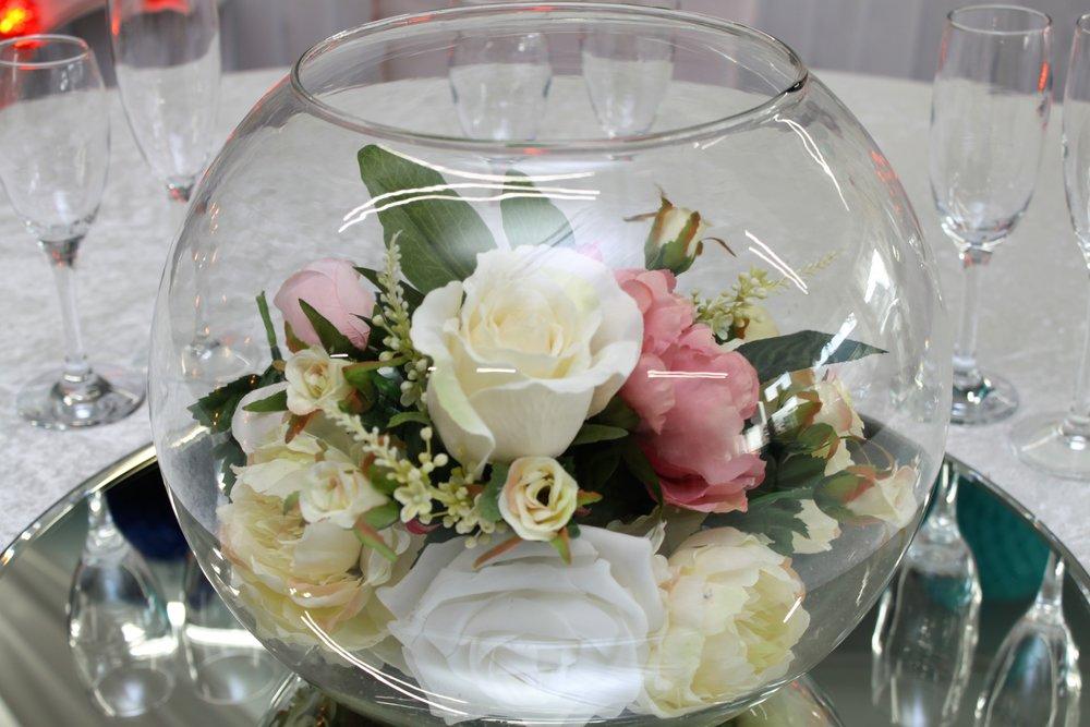 Goldfish Bowls - Traditional goldfish bowls make a versatile centrepiece that can be tailored to compliment any style or theme. Work well with flowers, floating candles and a wide range of fillings.Hire from only £10 each or 10 for £80!