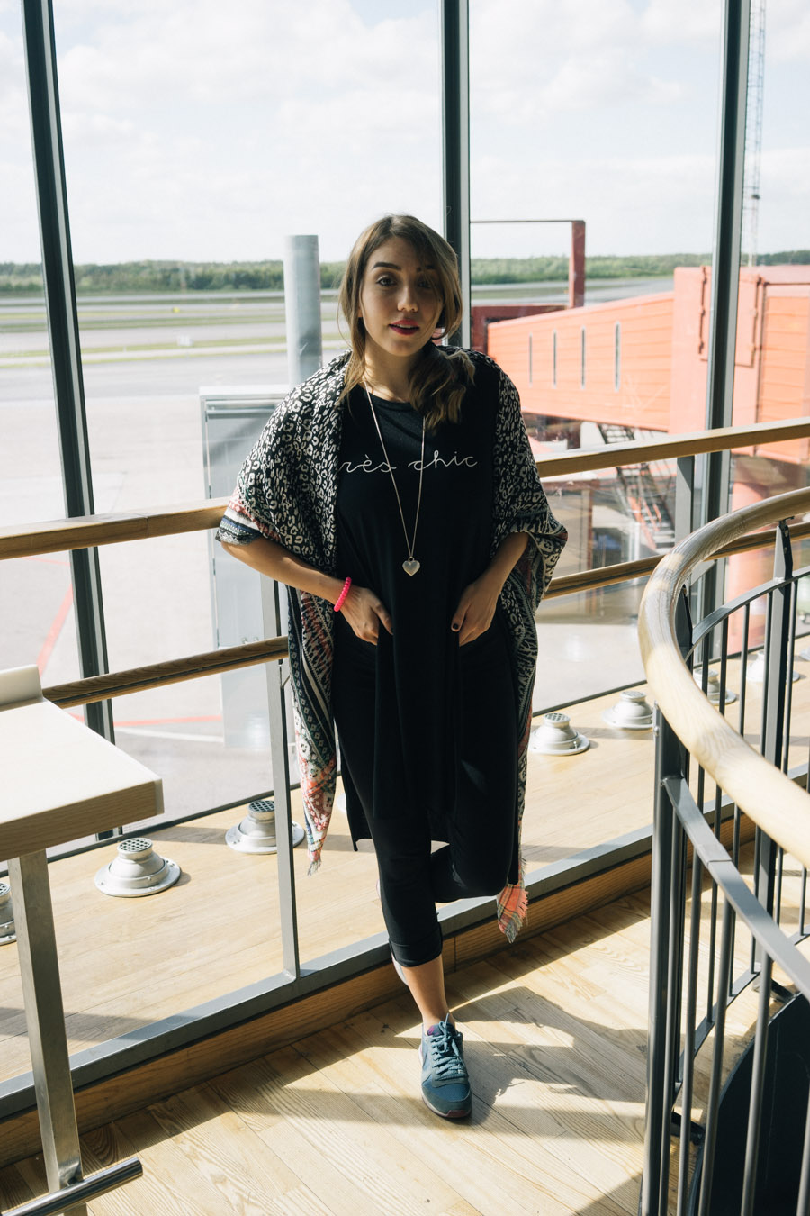 "MarinaSays travel outfit at Stockholm Airport featuring ""tres chic"" slit tee."