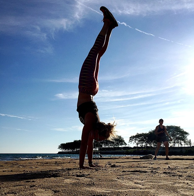 Stretching in a handstand
