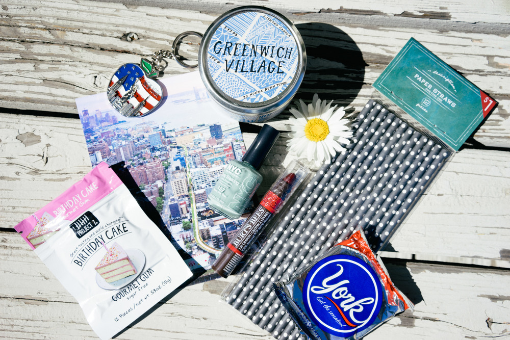 From left: Birthday Cake Gourmet Gum $2, High Line Post Card $1.75, NYC Key Chain $5, Greenwich Village Scented Candle from Urban Outfitters $15, NYC nail polish $3.75, Burt's Bees Lip Crayon $9, Paper Straws $1, York Patty $1. Not pictured here: Ghirardelli Chocolates.