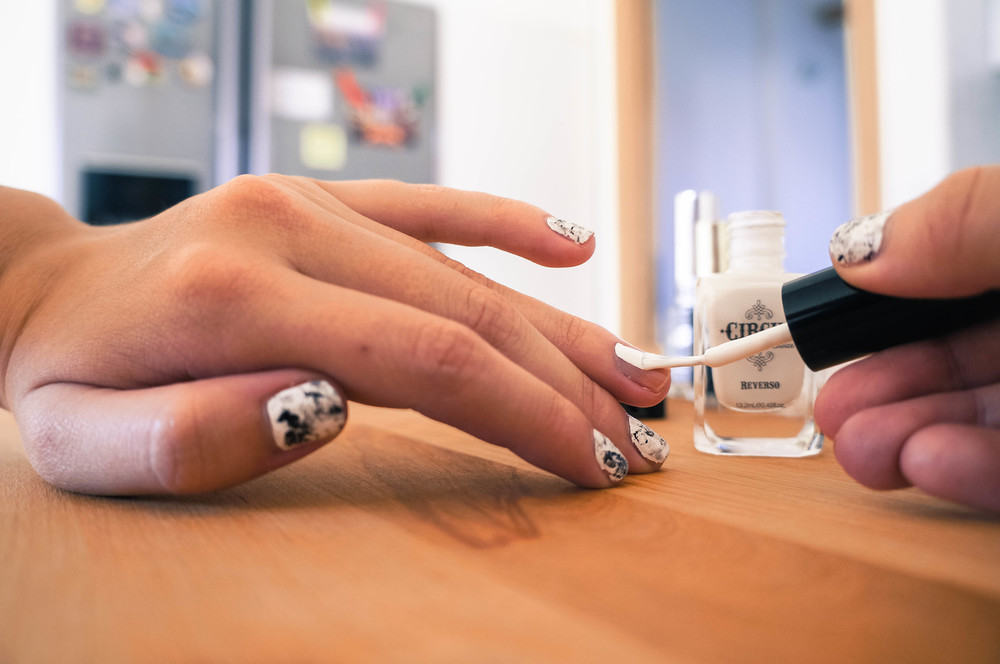 Apply an even coat of white nail polish as a base for your marble stone manicure. More at www.MarinaSays.com
