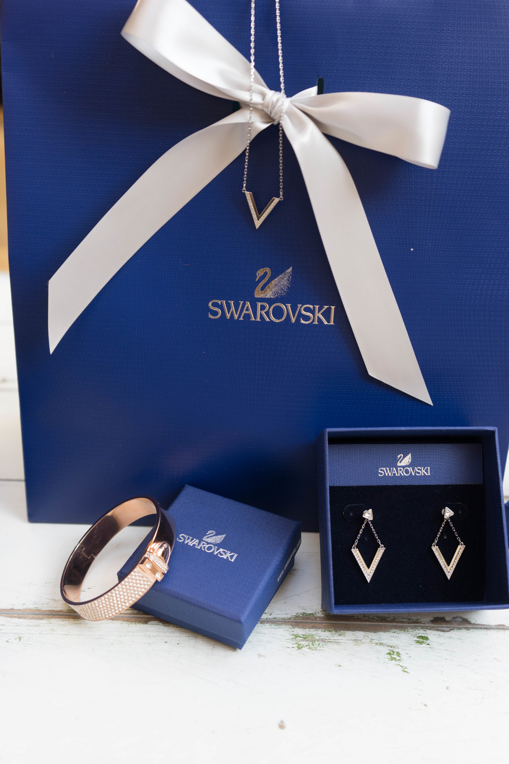 "Silver ""v"" necklace and earrings by Swarovski! Discover more style, life, and beauty confessions at www.MarinaSays.com"