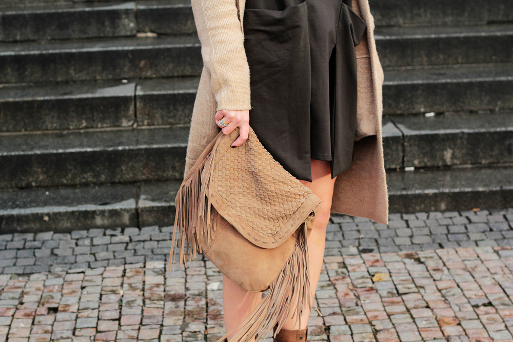 Olive green pockets, tan cardigan, and a fringe suede bag at www.MarinaSays.com