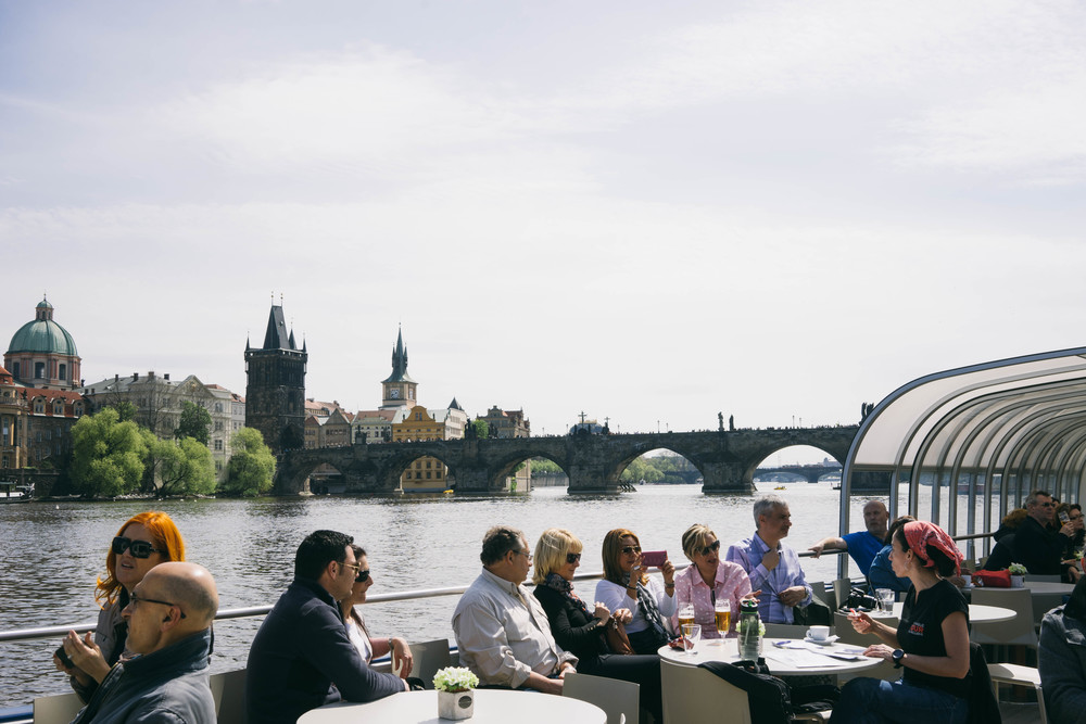 Scenic view of Prague's Charles Bridge via Vltava. All about the city of spires and why it makes a perfect destination for any blogger hoping to explore Europe at www.MARINASAYS.com