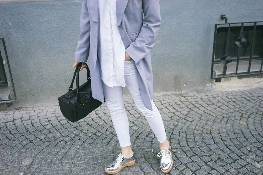 Silver shoes and an all white outfit with quarts blue longline blazer - get the look at www.MARINASAYS.com @marinasays