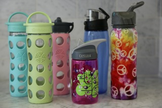 The Healthy Way to Drink Water Want to live a greener lifestyle? Start by drinking water more healthily. That sounds strange, I realize, but with more people choosing water to quench their thirst (over sugary drinks, which have major health consequences and pitfalls of their own) single serving water bottles are more available than ever before, but that doesn't mean it's the best method for consumption. You can buy a bottle of water at nearly every fast food chain, sporting events, movie theaters, airports, even coffee shops… but it will cost you and our planet. Let's talk about water for a moment. More than 60% of our body is comprised of water and staying hydrated is critical to our health and overall well-being.  It turns on digestion, helps keep hunger in check, controls thirst, keeps muscle function working properly, helps your kidneys, keeps your bowels moving, aids in weight loss…well, you get the picture.  Water should be your number one drink of choice. Every day. All daylong.  How much to drink? A lot of guidelines say half your body weight in ounces, but the easiest guide is what your urine looks like… the darker it is, the more water you need, but strive for 48 oz./day. Let's get back to the first point - drinking water in a healthy way for you and our planet. The healthiest way to drink water is from a BPA (Bisphenol-A) Free, reusable water bottle.  BPA is the commonly used designation for bisphenol A, a chemical found in many rigid plastic products, food and formula can linings, dental sealants, and on the shiny side of paper cashier receipts (to stabilize the ink). Exposure to this chemical has health consequences (see below).  The simple step of choosing a BPA free water bottle packs a lot of punch: It's good for our planet. Less plastic manufacturing, less trash in our landfills, less environmental impact from water companies pumping water from springs and recycling plastics and less consumption of oil from the manufacturing of the plastic bottles. The Ocean Conservancy reported that 1.1 million pounds of plastic beverage bottles were collected in 2012 from coastal cleanup initiatives… so much for recycling. It will save you money! If you drank the equivalent of eight glasses of water a day in plastic bottles, you'd spend about $1400/year.  The cost of a good quality, re-usable water bottle averages $15. Plus they come in all sizes so you can carry more water with you. Just think what you could do with that extra $1385! It's good for your health. Both the consumption of water and staying away from BPA mean a healthier body. The structure of BPA resembles estrogen, and as a result, exposure to it can affect how estrogen and other hormones act in the body, by mimicking or blocking them. This can disrupt the body's hormonal balance. Many women choose to limit their exposure to BPA and other estrogen-like chemicals because it is known that estrogen can make hormone-receptor-positive breast cancer develop and grow. Some experts have expressed concern that BPA exposure in early life may lead to an increased breast cancer risk later in life. (facts from www.breastcancer.org) And it can brighten your day.  There are so many variations on reusable water bottles that you can find a style to fit your mood, match your exercise clothes and even go with the time of year.  Most have a wide opening to make it easier to add ice and a large wedge of lemon.  If you haven't already made the switch to water as your primary hydration choice, make that your goal this week… and treat yourself to a fun, new reusable water bottle to celebrate a step toward better health for you and a healthier planet for all of us.