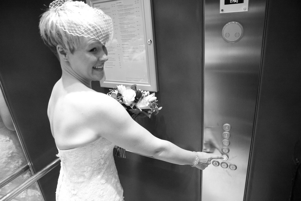 bride getting in a lift Radisson Blu Durham