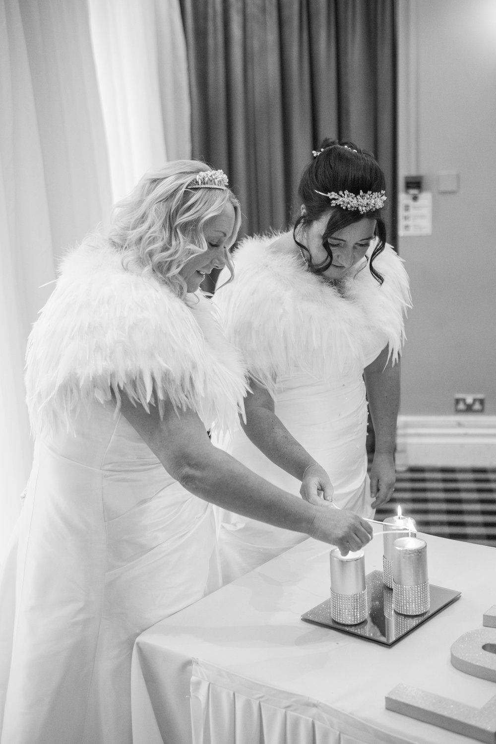 lighting candles at a civil ceremony at Bowburn Hall Hotel County Durham