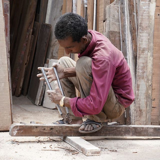 Tools of the trade! Recycling wood from old buildings is a daily chore for this worker. #chorbazaar #bazaar #wood #reclaimedwood #recycle #streetphotography #street #urbexphotography #toolsofthetrade #tools