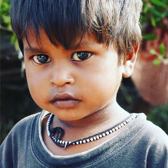 Seeing the plastic littered world around you through big brown eyes - but not knowing differently. #browneyes #bigeyes #seeing #plasticfree #life #street #streetphotography #child