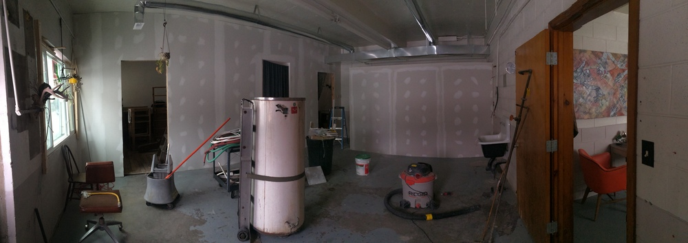 Panorama of the common area after hanging drywall and some initial plastering. Three doorways in the left half of the picture are the artist rooms and the shared kitchen is to the right.
