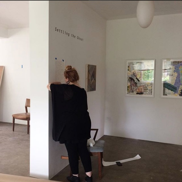 - Curator Kate Mothes/Young Space installing Settling the Ghost, July 2017.
