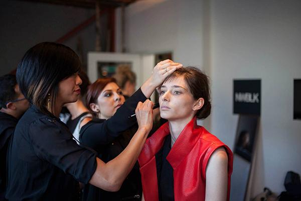 Backstage doing makeup for a fashion show for designer, Melissa Fleis.