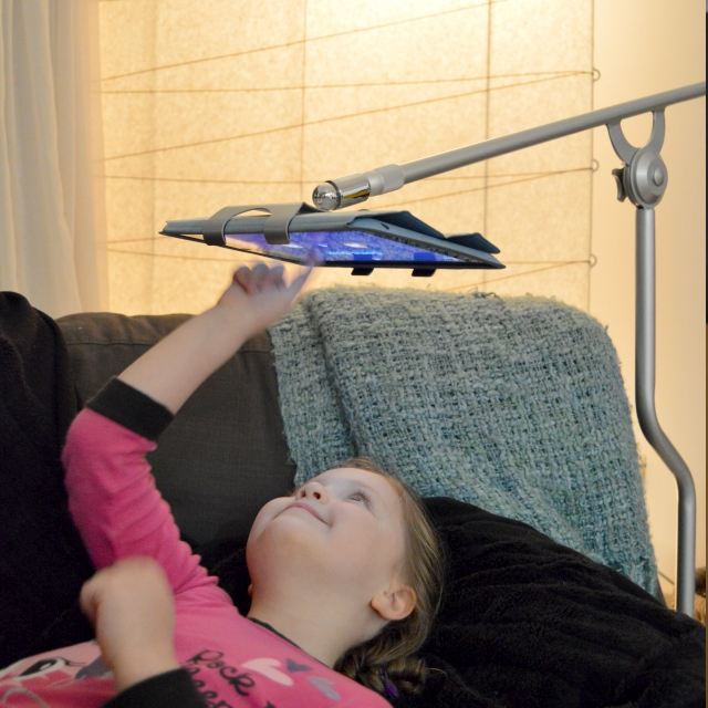 girl using FLOTE iPad Tablet Bed Stand