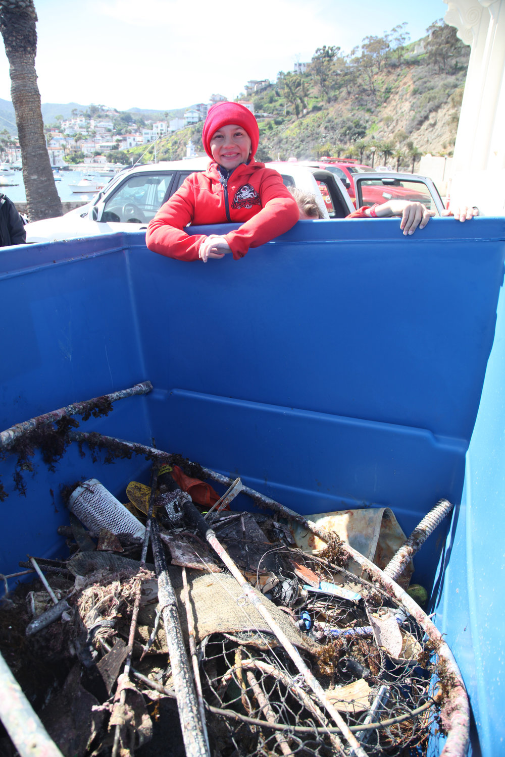 Beach Cleanup - posing at collected dumpster trash pile.jpg