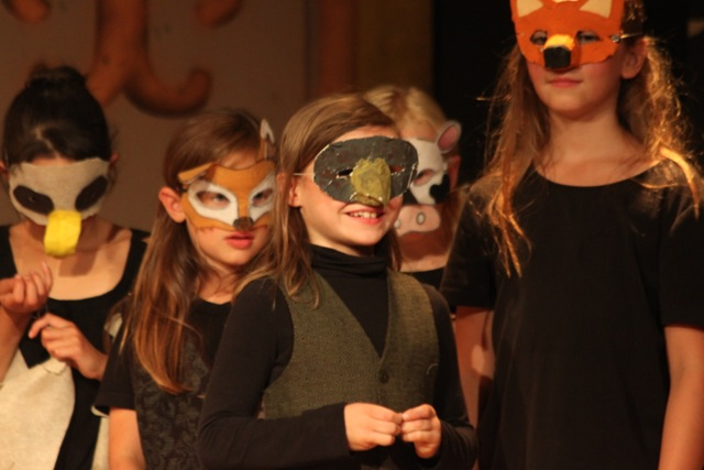 In 2014 students got to make their own animal masks during art time, and we used them in the show