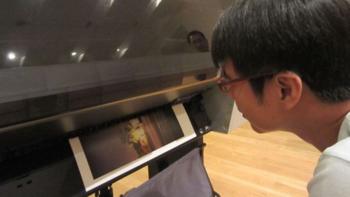 Espon printing. Watching magic happen before our eyes. / Photo Credit: OKJ Photography