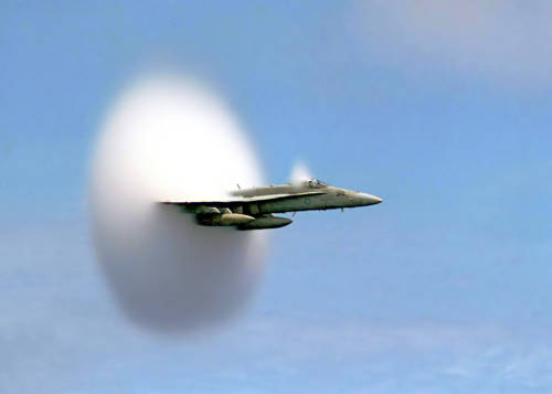 A picture of a fighter jet just before it hits Mach 1. / Photo Credit:    U.S. Navy   via Wikipedia