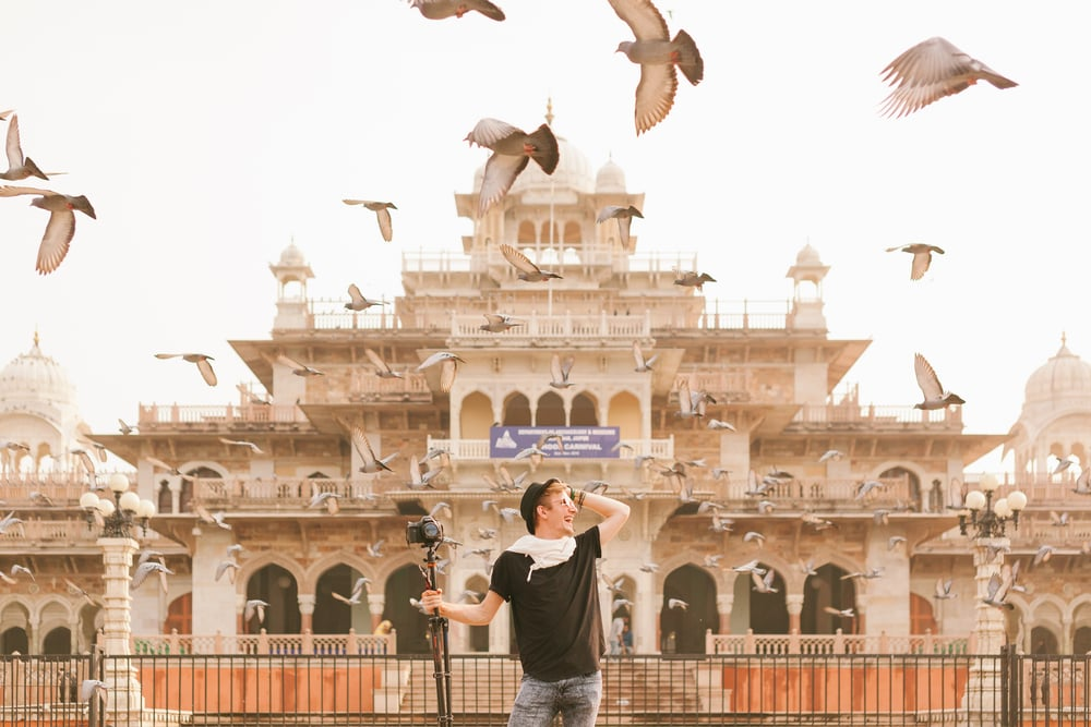Rob surrounded by birds in Jaipur