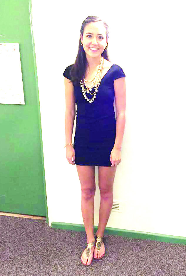 Molly Spiegel '15 wearing a simple LBD. Accessorized with small simple earrings and a statement necklace and gold sandals
