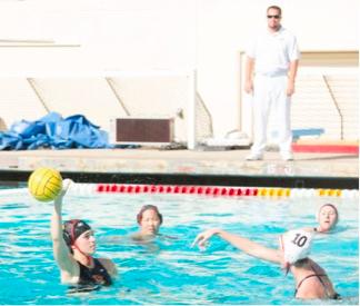 Thomason takes control of the ball for CMS water polo.  Photo courtesy of Helen Thomason