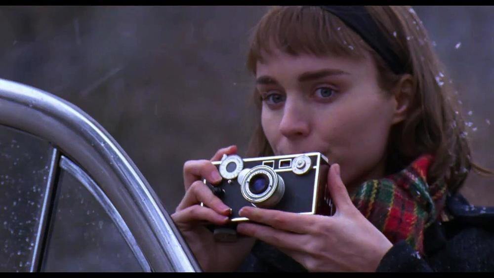 Rooney Mara plays Therese Belivet, a shopgirl and photographer who falls for Carol. Photo courtesy of Daily Motion.